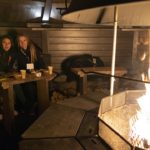 Guests enjoying meal in borealis point's laplander's hut